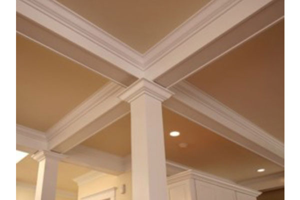 Crown Moulding Installed To Conceal Home Theater Wiring